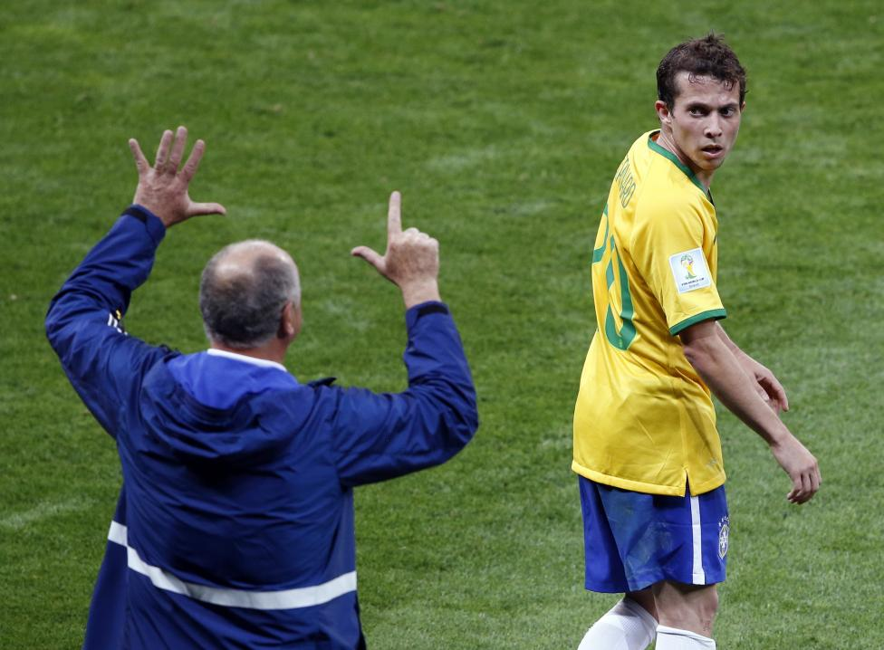 Brazil's coach Luiz Felipe Scolari gestures to Bernard during their 2014 World Cup semi-finals against Germany at the Mineirao stadium in Belo Horizonte