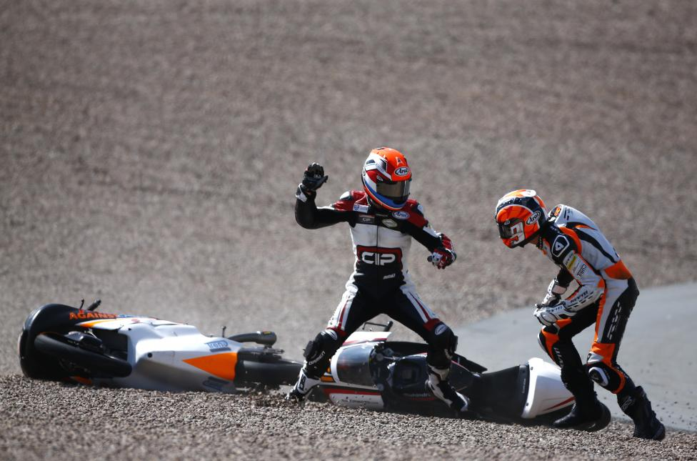 Mahindra Moto3 rider Schouten of the Netherlands fights with compatriot Kalex KTM Moto3 rider Deroue after they crashed during the German Grand Prix at the Sachsenring circuit in the eastern German town of Hohenstein-Ernstthal