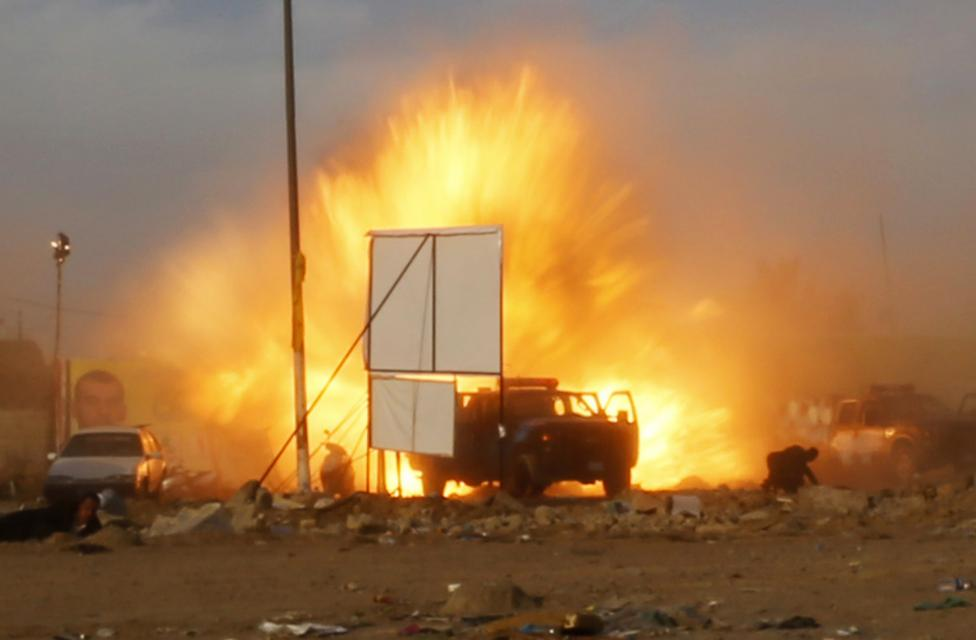 An explosion is seen during a car bomb attack at a Shi'ite political organisation's rally in Baghdad