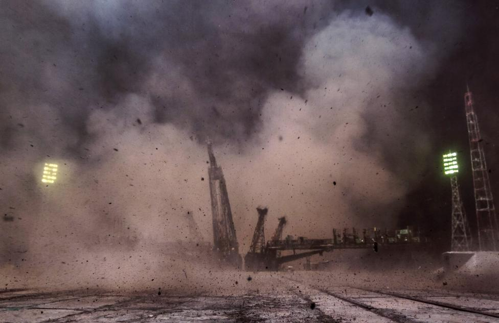 Debris flies after the Soyuz TMA-14M spacecraft carrying the International Space Station crew blasted off from the launch pad at the Baikonur cosmodrome