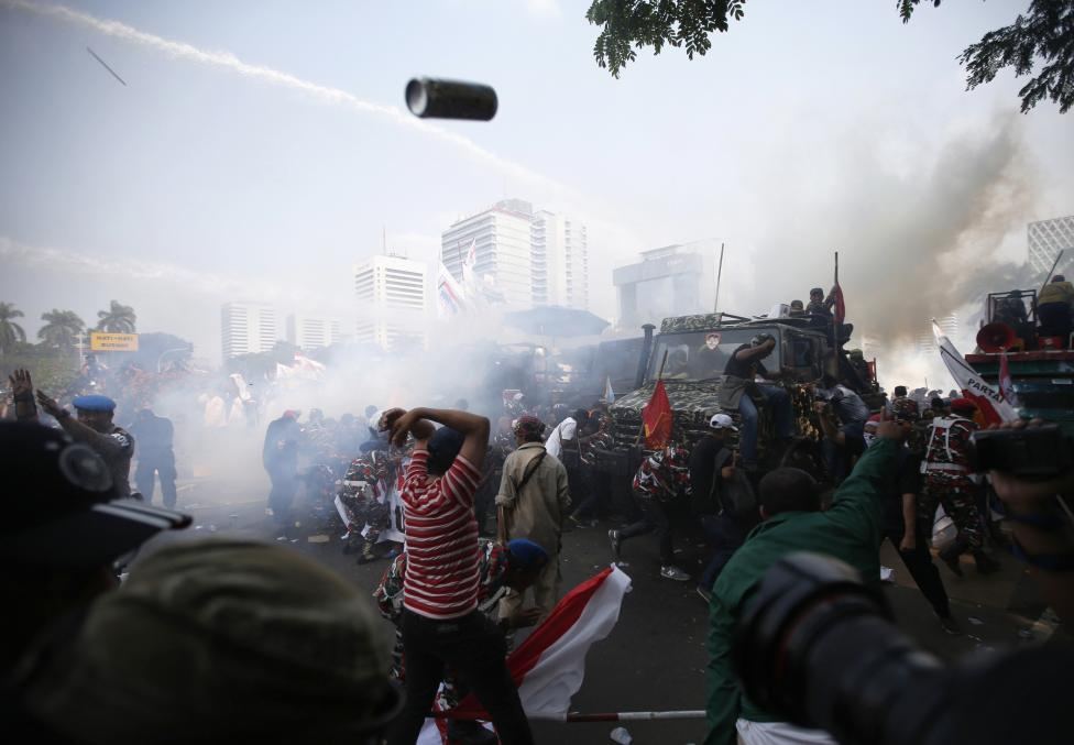 Indonesian police use tear gas and water cannon to disperse supporters of presidential candidate Prabowo Subianto during a protest near the Constitutional Court in Jakarta