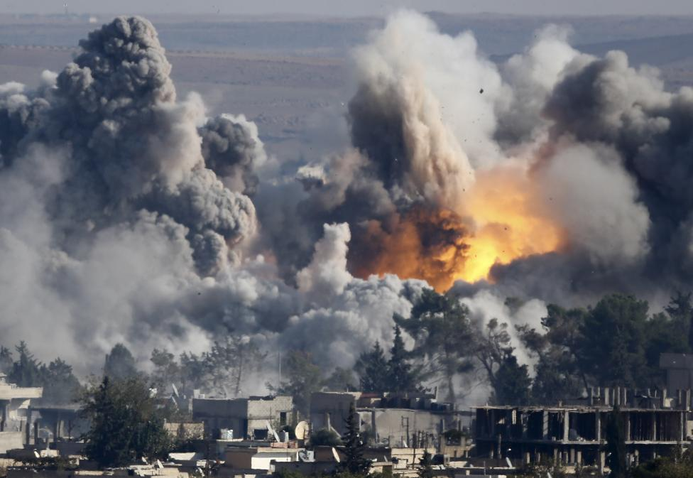 Smoke rises over Syrian town of Kobani after an airstrike, as seen from the Mursitpinar border crossing on the Turkish-Syrian border