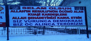 Bitlis'te Kuarşi kardeşlere destek afişi!
