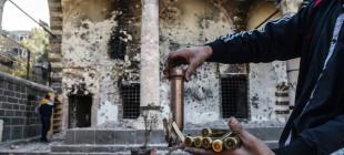 AFP'den 11 fotoğrafla Sur'daki çatışmalar ve tahrip edilen tarih